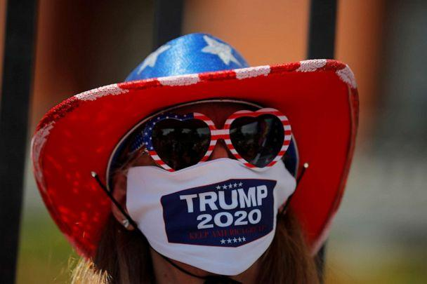 PHOTO: Donna Harkness wears a mask with 'Trump 2020' printed on it at a demonstration to demand the lifting of restrictions imposed by state and local officials to fight the spread of the coronavirus in Boston, May 30, 2020. (Brian Snyder/Reuters)