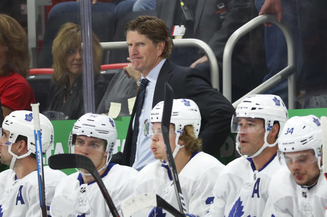Toronto Maple Leafs coach Mike Babcock watches during the first period of the team's NHL hockey game against the Detroit Red Wings, Thursday, Oct. 11, 2018, in Detroit. (AP Photo/Paul Sancya)
