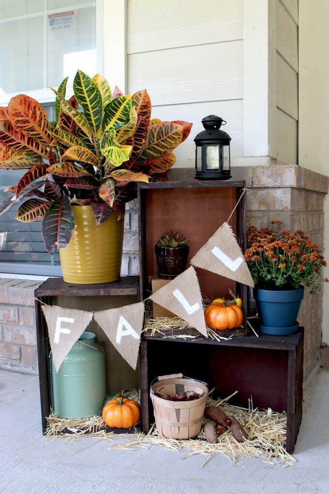 """<p>There's something decidedly charming about this scene. A few wooden crates are the perfect home for a few fall plants and a simple burlap banner.</p><p><strong>See more at <a href=""""http://grayhousestudio.com/fall-crate-display/"""" rel=""""nofollow noopener"""" target=""""_blank"""" data-ylk=""""slk:Gray House Studio"""" class=""""link rapid-noclick-resp"""">Gray House Studio</a>.</strong></p><p><strong><a class=""""link rapid-noclick-resp"""" href=""""https://go.redirectingat.com?id=74968X1596630&url=https%3A%2F%2Fwww.walmart.com%2Fsearch%2F%3Fquery%3Dwooden%2Bcrate&sref=https%3A%2F%2Fwww.thepioneerwoman.com%2Fhome-lifestyle%2Fdecorating-ideas%2Fg36732301%2Foutdoor-fall-decorations%2F"""" rel=""""nofollow noopener"""" target=""""_blank"""" data-ylk=""""slk:SHOP WOODEN CRATES"""">SHOP WOODEN CRATES</a></strong></p>"""