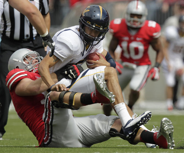 Ohio State's Garrett Goebel, left, sacks California's Zach Maynard during the second quarter of an NCAA college football game Saturday, Sept. 15, 2012, in Columbus, Ohio. (AP Photo/Jay LaPrete)