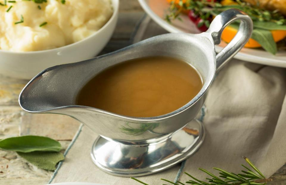 <p>Homemade gravy can make or break your meal, and it's surprisingly easy to prepare. Once your turkey comes out of the oven, pour the pan drippings in a glass measuring cup. Then, pour the drippings through a strainer to remove any solid matter. After a few minutes, the fat will float to the top. Using a ladle, scoop the fat from the pan drippings and place about a quarter-cup of the fat into a saucepan while reserving the rest of the pan drippings. Over medium heat, bring the fat to a sizzle. Then, add 1/4 cup of flour to the fat, while whisking continuously to remove lumps of flour, in order to create a roux. Whisk until you have a smooth paste. Continue to cook, constantly whisking for a few more minutes until it's a light golden brown. Next, add the remainder of the pan drippings to the roux (minus the fat), adding just a little bit at a time, whisking constantly to avoid lumps. Continue whisking and adding pan drippings until they run out. At this point, supplement with chicken or turkey stock, adding small amounts at a time until the gravy is the consistency that you want. Season the gravy to your liking, and add finely chopped herbs including sage, rosemary and thyme, if desired. Allow to simmer for several minutes, and keep some extra stock on hand because it'll thicken up a little as it cools.</p>