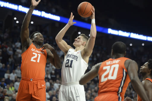 Penn State's John Harrar (21) puts up a one handed shot next to Illinois' Kofi Cockburn (21) during the first half of an NCAA college basketball game Tuesday, Feb. 18, 2020, in State College, Pa. (AP Photo/Gary M. Baranec)