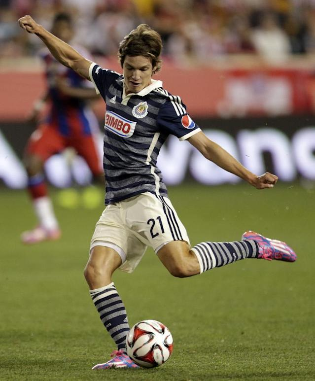 Chivas' Carlos Fierro takes a shot against Bayern Munich during the second half of an international friendly soccer match at Red Bull Arena, Thursday, July 31, 2014, in Harrison, N.J. Bayern Munich won 1-0. (AP Photo/Julio Cortez)