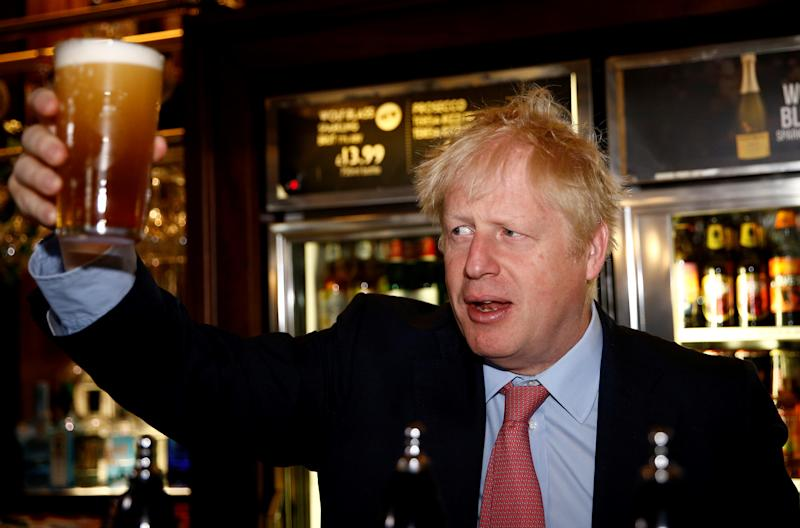 Conservative leadership contender Boris Johnson poses with a pint of beer during his visit to JD Wetherspoon's Metropolitan Bar in London, on July 10, 2019. (Photo by HENRY NICHOLLS / POOL / AFP) (Photo credit should read HENRY NICHOLLS/AFP/Getty Images)