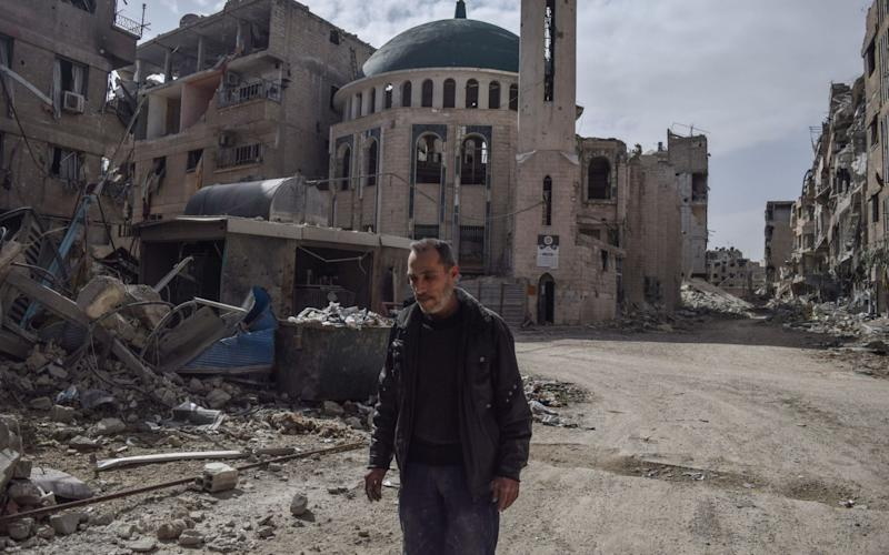 Abu Gassan, muezzin of the Huzaifa Mosque in Eastern Ghouta, which was destroyed during the airstrikes  - Anadolu
