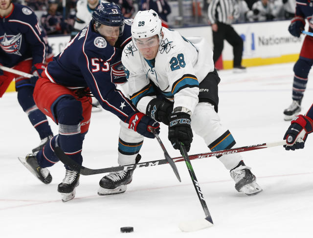 Columbus Blue Jackets' Gabriel Carlsson, left, of Sweden, and San Jose Sharks' Timo Meier, of Switzerland, battle for the puck during the first period of an NHL hockey game Saturday, Jan. 4, 2020, in Columbus, Ohio. (AP Photo/Jay LaPrete)