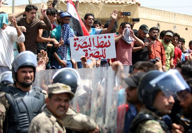 "A protest sign held during demonstrations in the southern city of Basra on July 15, 2018, reads ""Basra's oil belongs to Basra"""