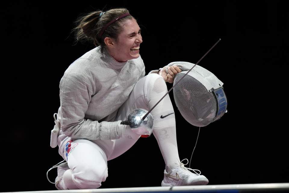 Sofia Pozdniakova celebrates after the gold at the women's individual Sabre final competition at the 2020 Summer Olympics, Monday, July 26, 2021, in Chiba, Japan. (AP Photo/Andrew Medichini)
