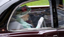 Britain's Queen Elizabeth II arrives by car during day five of of the Royal Ascot horserace meeting, at Ascot Racecourse, in Ascot, England, Saturday June 19, 2021. (Andrew Matthews/PA via AP)