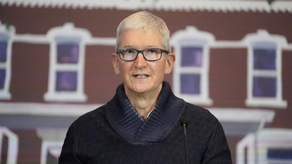 Apple's CEO Tim Cook speaks during a news conference Wednesday, Oct. 13, 2021, in Salt Lake City. Cook and NBA All-Star Dwyane Wade joined Utah leaders to announce the completion of a local advocacy group's campaign to build eight new homes for LGBTQ youth in the U.S. West. (AP Photo/Rick Bowmer)