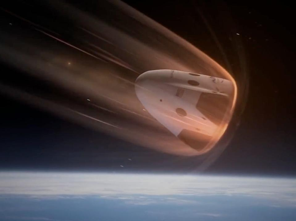 An illustration showing SpaceX's Crew Dragon spaceship returning to Earth and withstanding intense heat from atmospheric reentry.