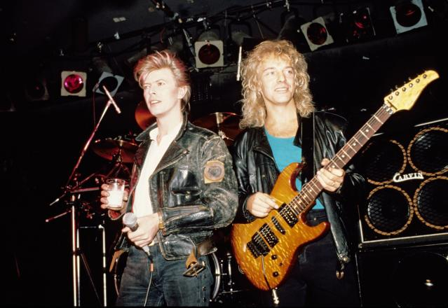 and David Bowie with Peter Frampton, performing live onstage at the Cat Club (Photo by Ebet Roberts/Redferns)