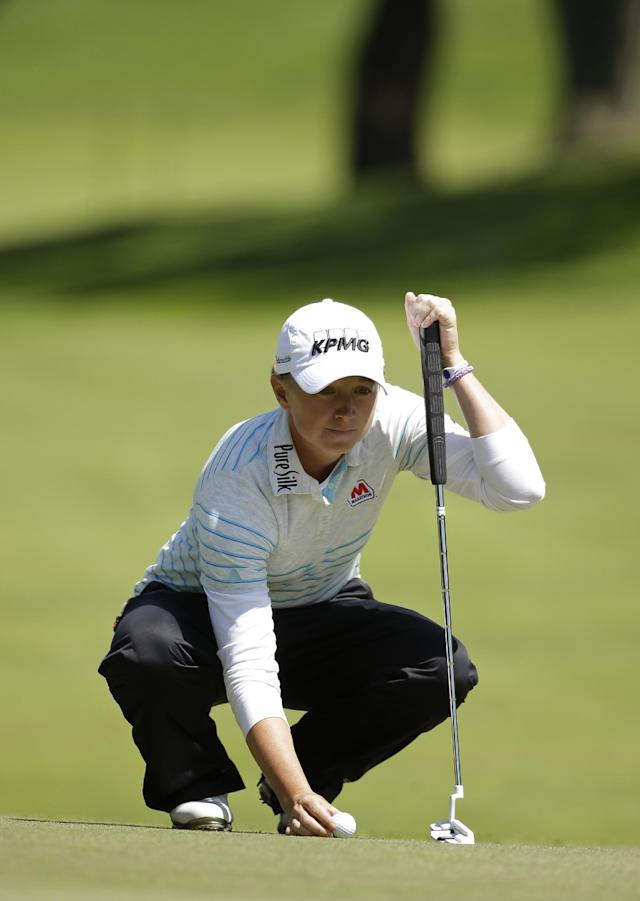 Stacy Lewis lines up a putt on the fifth green of Lake Merced Golf Club during the final round of the Swinging Skirts LPGA Classic golf tournament on Sunday, April 27, 2014, in Daly City, Calif. (AP Photo/Eric Risberg)