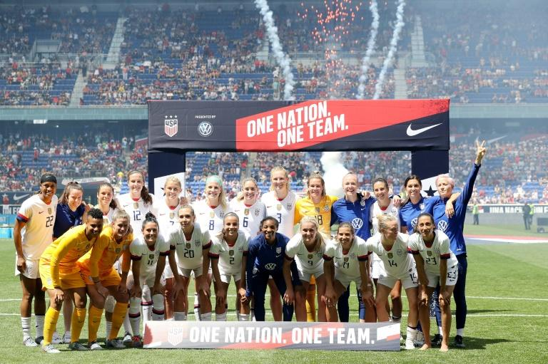 The USA pose for pictures after beating Mexico 3-0 in their last warm-up match for their  Women's World Cup title defense