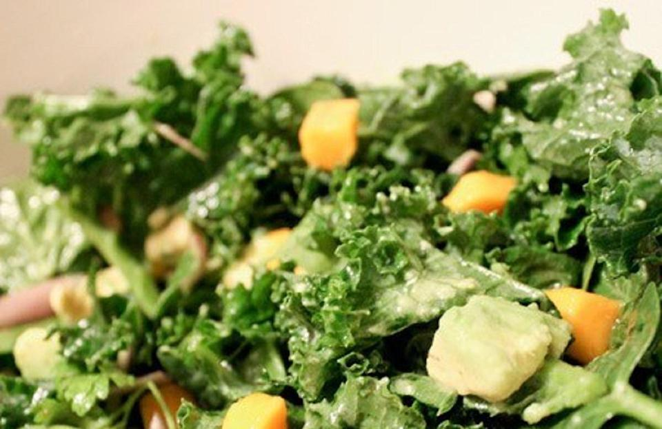 """<p>If you've ever made a kale salad and the lettuce tasted stiff and flavorless, that's because you're missing a crucial step: massaging the kale. Mixing the kale with lemon, olive oil and a little salt will make the leaves softer and more flavorful. It'll taste just like it does at Sweetgreen!</p> <p><a href=""""https://www.thedailymeal.com/recipes/kale-mango-and-avocado-salad-recipe?referrer=yahoo&category=beauty_food&include_utm=1&utm_medium=referral&utm_source=yahoo&utm_campaign=feed"""" rel=""""nofollow noopener"""" target=""""_blank"""" data-ylk=""""slk:For the Kale, Mango, and Avocado Salad recipe, click here."""" class=""""link rapid-noclick-resp"""">For the Kale, Mango, and Avocado Salad recipe, click here.</a></p>"""