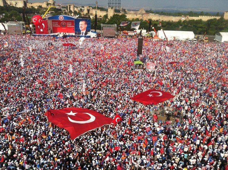 Thousands of people gather in Istanbul to listen to a speech by Turkish Prime Minister Recep Tayyip Erdogan on June 16, 2013. Two of Turkey's main trade unions began a nationwide strike to protest at police violence against anti-government demonstrators, a day after Prime Minister Recep Tayyip Erdogan defended his crackdown on an Istanbul protest park