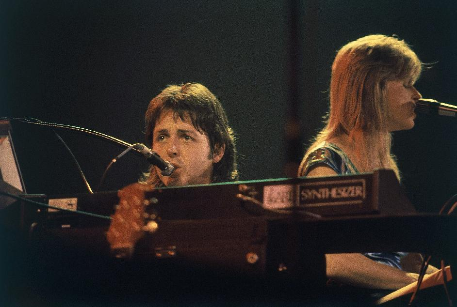 FILE - In this May 9, 1976 file photo, Paul McCartney and his wife Linda McCartney perform in concert at Maple Leaf Gardens in Toronto along with their band Wings. McCartney turned 70 years of age Monday June 18, 2012. (AP Photo/File)