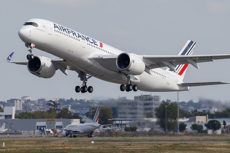 FILE PHOTO: The first Air France airliner's Airbus A350 takes off after a ceremony at the aircraft builder's headquarters in Colomiers near Toulouse