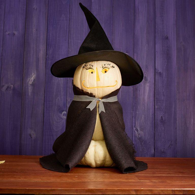 """<p>If you've got a scrap piece of black cloth and a witch's hat sitting in your dress-up drawer, then you've got all you need to put together this adorable pumpkin creation. </p><p><a class=""""link rapid-noclick-resp"""" href=""""https://www.amazon.com/Sunniess-Attractive-Handmade-Reusable-Eyelashes/dp/B0755ZX97D/?tag=syn-yahoo-20&ascsubtag=%5Bartid%7C10070.g.331%5Bsrc%7Cyahoo-us"""" rel=""""nofollow noopener"""" target=""""_blank"""" data-ylk=""""slk:SHOP FAKE EYELASHES"""">SHOP FAKE EYELASHES</a> </p>"""