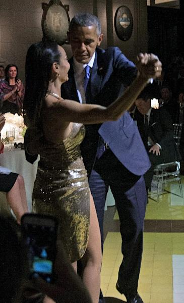 US President Barack Obama dances tango with Argentinian dancer Mora Godoy during a state dinner in Buenos Aires (AFP Photo/Nicholas Kamm)