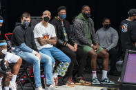 Los Angeles Lakers center Marc Gasol, forward Kyle Kuzma, forward Anthony Davis and forward LeBron James sit on the bench during the first half of the team's NBA basketball game against the Brooklyn Nets, Saturday, April 10, 2021, in New York (AP Photo/Corey Sipkin)