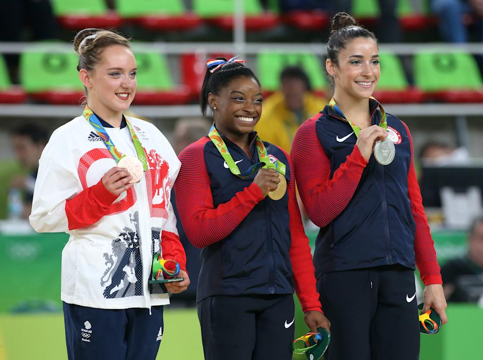 RIO DE JANEIRO, BRAZIL - AUGUST 16: Bronze medalist Amy Tinkler of Great Britain, gold medalist Simone Biles of USA, silver medalist Alexandra Raisman of USA pose during the medal ceremony for the Women's Floor Exercise on day 11 of the Rio 2016 Olympic Games at Rio Olympic Arena on August 16, 2016 in Rio de Janeiro, Brazil. (Photo by Jean Catuffe/Getty Images)