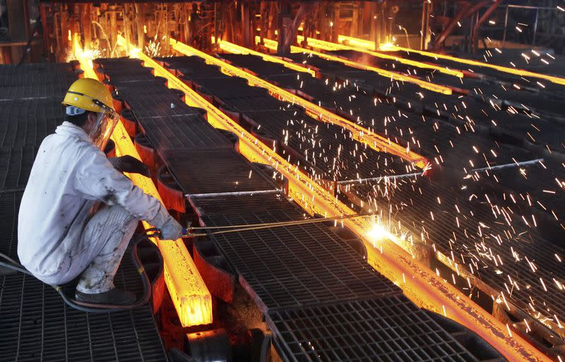 A worker cut steel bars at a steel plant in Ganyu