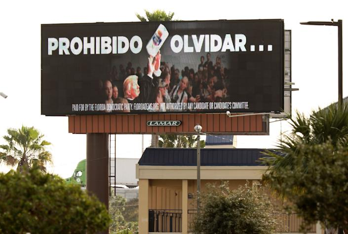 "In January, the Florida Democratic Party purchased a billboard reading ""Never Forget"" in Spanish to remind Puerto Rican voters of Trump's dismissive approach in the wake of Hurricane Maria, which devastated the island in 2017.  (Photo: GREGG NEWTON via Getty Images)"
