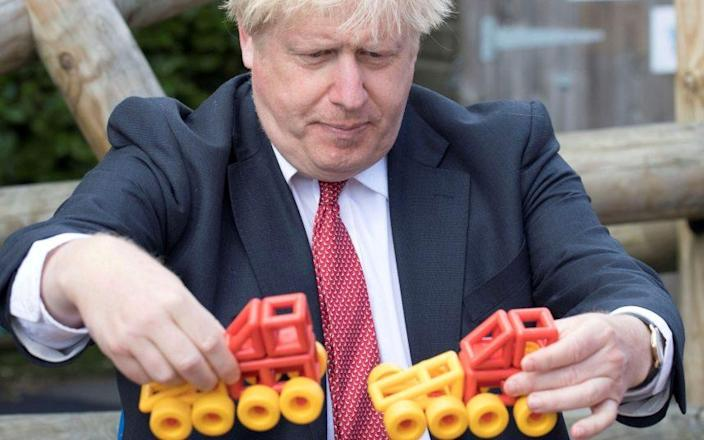 The PM, playing with toys at a school yesterday, will come under pressure to take a tougher line - Jeremy Selwyn/Reuters