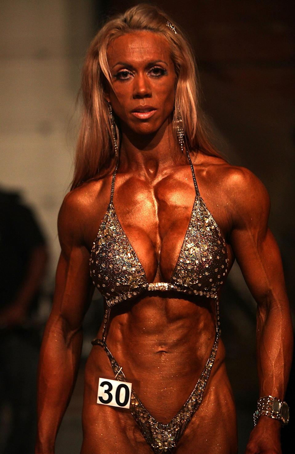 "<div class=""caption-credit""> Photo by: Christopher Furlong/Getty Images</div>Another bygone look from years past: bleached blonde hair. ""A lot more of us used to be platinum,"" says Howlett. ""My hair was falling out in clumps from all the chemicals."" Now brunettes are having a moment in bodybuilding, thanks in part to the competition's popularity in countries outside the U.S. <br>"