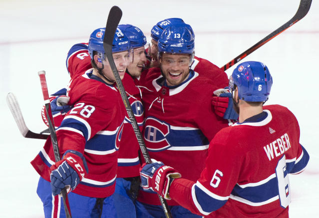 Teammates gather around Montreal Canadiens' Brendan Gallagher (11) to celebrate his hat trick during the second period of an NHL hockey game against the Philadelphia Flyers on Thursday, Feb. 21, 2019, in Montreal. (Paul Chiasson/The Canadian Press via AP)