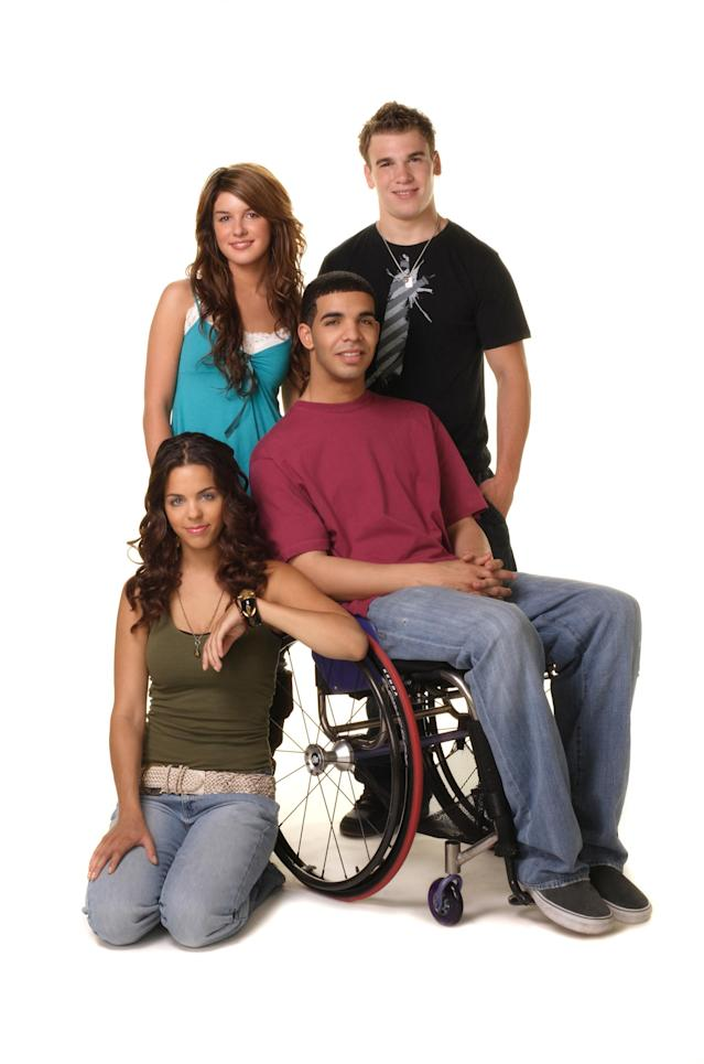 Melissa McIntyre, Shenae Grimes, Shane Kippel, and Drake in <em>Degrassi: The Next Generation.</em> (Photo: CATV/Courtesy Everett Collection)