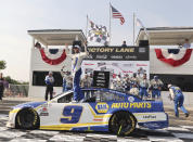 Chase Elliott (9) celebrates his victory in a NASCAR Cup Series auto race Sunday, July 4, 2021, at Road America in Elkhart Lake, Wis. (AP Photo/Jeffrey Phelps)