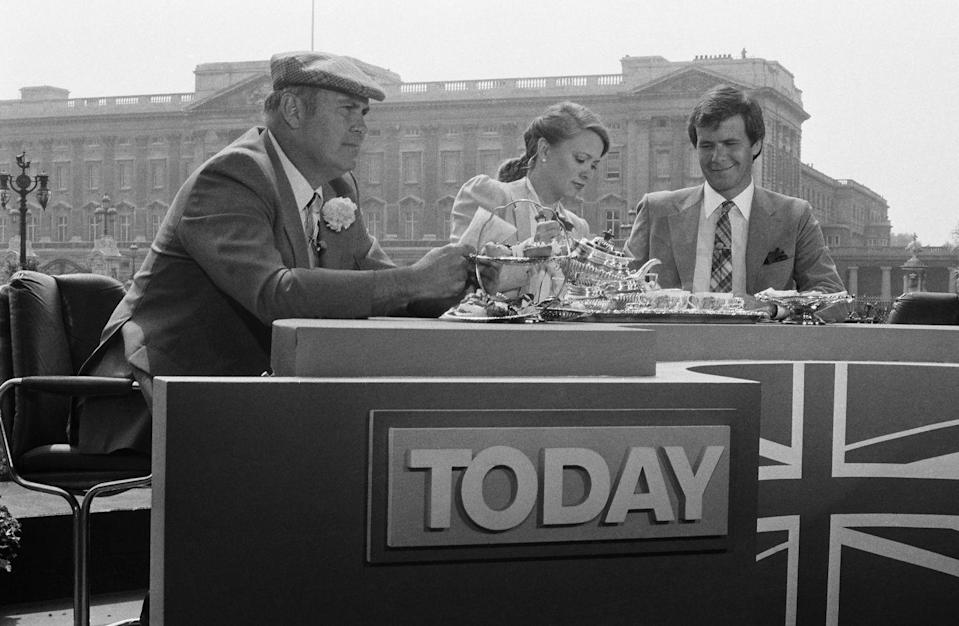 <p>Press from every nation, including the United States, set up outposts to live broadcast the events. Here, <em>Today </em>hosts Willard Scott, Jane Pauley, and Tom Brokaw enjoy a spot of tea before the ceremony. </p>