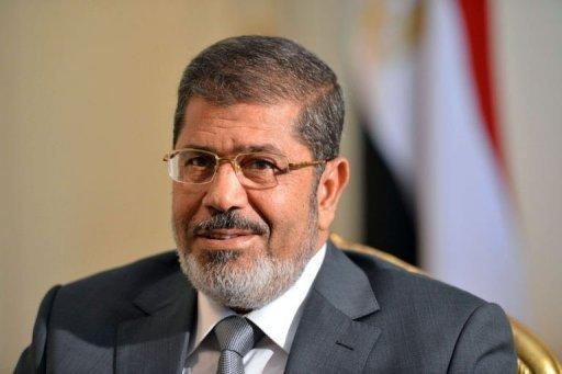 """Egypt's Supreme Constitutional Court said that all of its rulings were """"binding,"""" in response to a presidential decree by Mohamed Morsi, seen here on July 8, reinstating parliament after the court ruled the house invalid"""