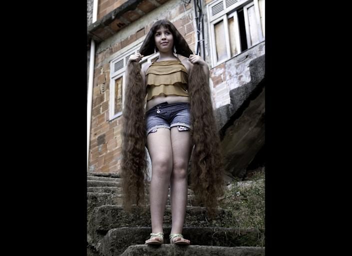 Natasha Moraes de Andrade, 12, is nicknamed Rapunzel because her hair is more than 5 feet long -- just one and a half inches shorter than her height. In March, she planned to cut and sell the locks for some $2,600 to help get her family in Rio De Janeiro out of poverty.