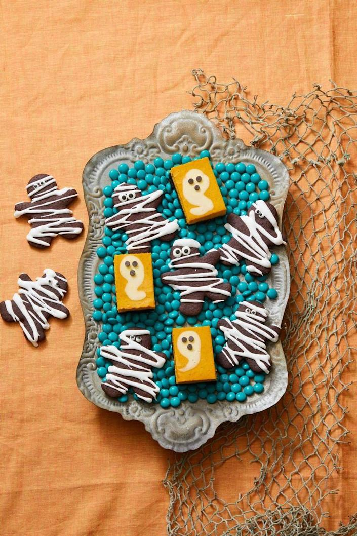 """<p>These cheesecake bars are flavored with pumpkin puree.</p><p><em><strong><a href=""""https://www.womansday.com/food-recipes/a33562053/pumpkin-cheesecake-ghosts-recipe/"""" rel=""""nofollow noopener"""" target=""""_blank"""" data-ylk=""""slk:Get the Pumpkin Cheesecake Ghosts recipe."""" class=""""link rapid-noclick-resp"""">Get the Pumpkin Cheesecake Ghosts recipe.</a></strong></em></p>"""