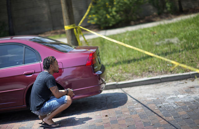 <p>Calvin McNeil, who was in the Pulse nightclub at the time of a mass shooting, returns to the scene to look for his car, June 13, 2016, in Orlando, Fla. (AP Photo/David Goldman) </p>