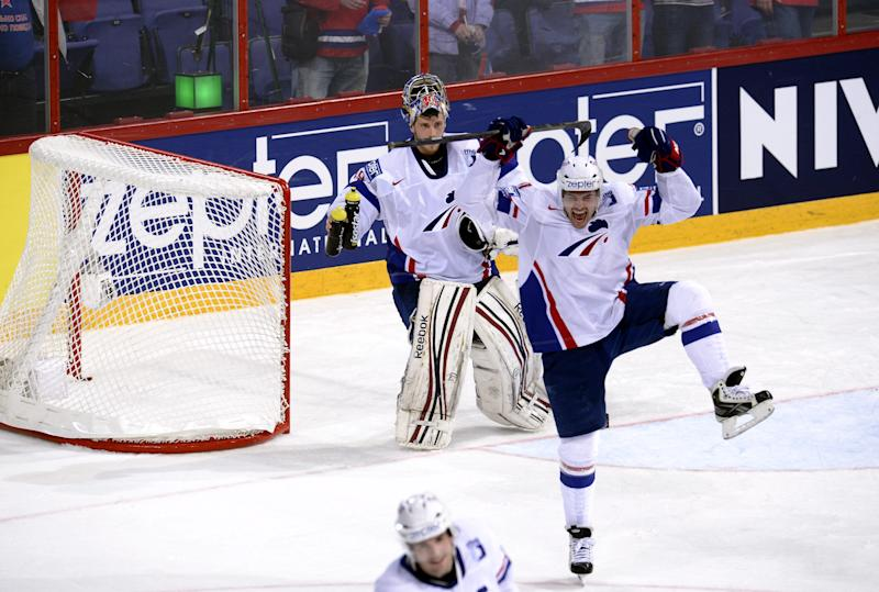 Team France's Sacha Treille  celebrates after the match when they beat Russia 2-1 during  the 2013 Ice Hockey World Championships preliminary round match Russia vs France in Helsinki, Finland on Thursday, May 9, 2013.  At back is France's goalie Florian Hardy.   (AP Photo / LEHTIKUVA / Heikki Saukkomaa)  FINLAND OUT