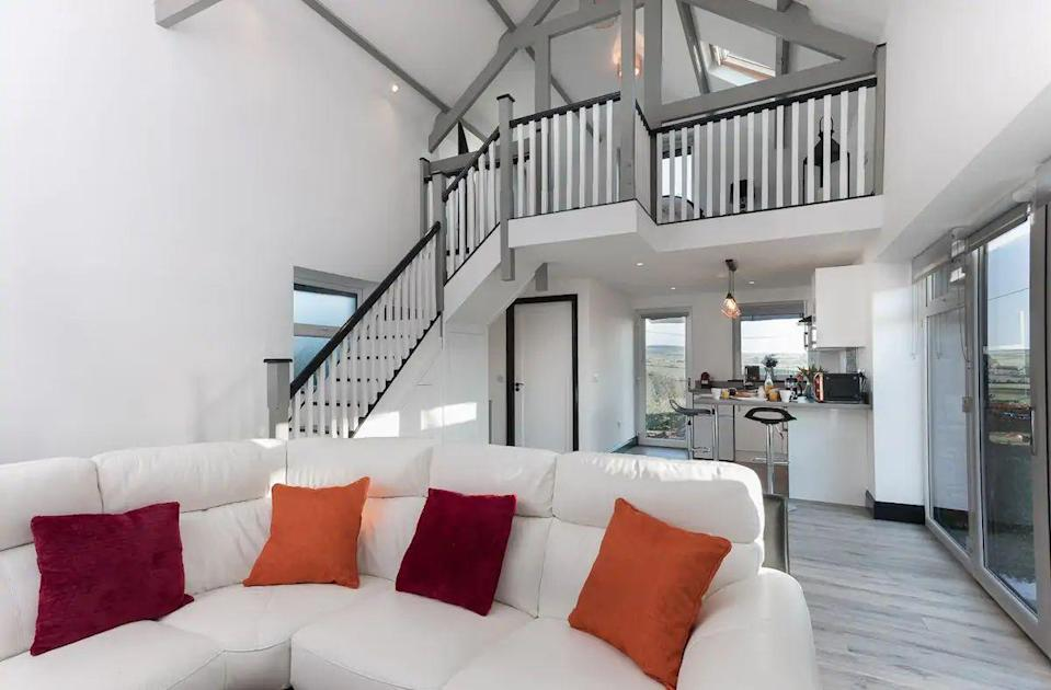 """<p>Escape to County Cork and check into this stylish lodge near the picturesque town of Kinsale. You'll find exposed wood beams, vaulted ceilings and traditional stone work at this Airbnb, which is one of three nestled inside the courtyard of a farm. It's a great grown-ups base for exploring the Wild Atlantic Way, with alpacas and horses in the grounds. </p><p><strong>Sleeps: </strong>2</p><p><a class=""""link rapid-noclick-resp"""" href=""""https://airbnb.pvxt.net/e4A3Er"""" rel=""""nofollow noopener"""" target=""""_blank"""" data-ylk=""""slk:SEE INSIDE"""">SEE INSIDE</a></p>"""