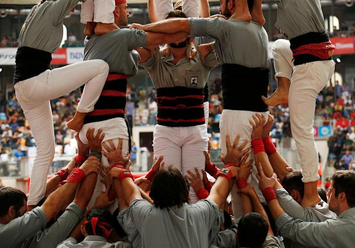 """<p>Castellers de Sants start to form a human tower called """"castell"""" during a biannual competition in Tarragona city, Spain, Oct. 2, 2016. (REUTERS/Albert Gea)</p>"""