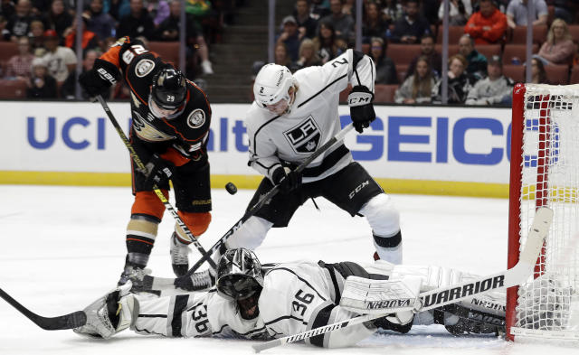 Los Angeles Kings goaltender Jack Campbell, bottom, lays out to stop a shot on goal under Anaheim Ducks' Devin Shore, top left, and Kings' Paul LaDue during the second period of an NHL hockey game Friday, April 5, 2019, in Anaheim, Calif. (AP Photo/Marcio Jose Sanchez)