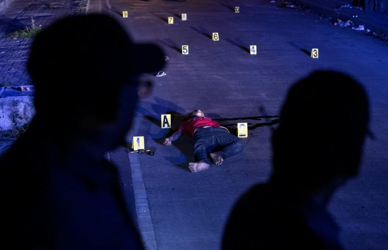 The body of an alleged drug dealer killed during a police anti-drug operation is seen on the ground in Manila on August 18, 2017