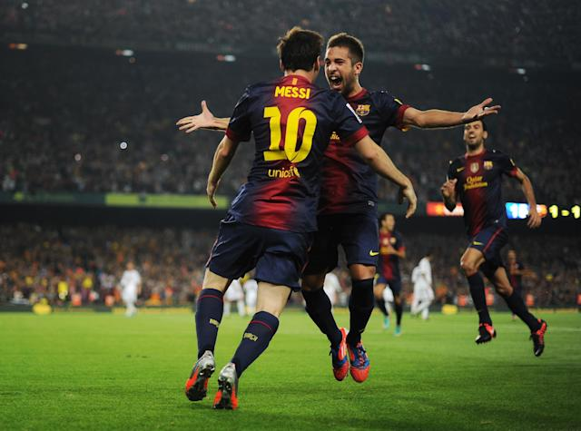 BARCELONA, SPAIN - OCTOBER 07: Lionel Messi (L) of Barcelona celebrates scoring with his teammate Jordi Alba during the la Liga match between FC Barcelona and Real Madrid at the Camp Nou stadium on October 7, 2012 in Barcelona, Spain. (Photo by Jasper Juinen/Getty Images)