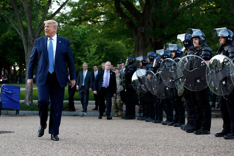 President Donald Trump walks past police in riot gear in Lafayette Park after he stood for photos Monday in front of St. John's Episcopal Church. (Photo: Patrick Semansky/ASSOCIATED PRESS)