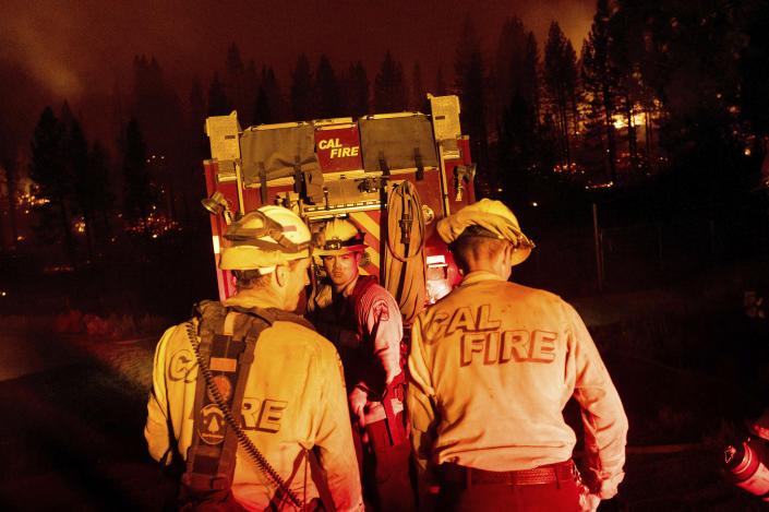 Firefighters work to stop the Sugar Fire, part of the Beckwourth Complex Fire, from spreading near Frenchman Lake in Plumas National Forest, Calif., on Thursday, July 8, 2021. (AP Photo/Noah Berger)