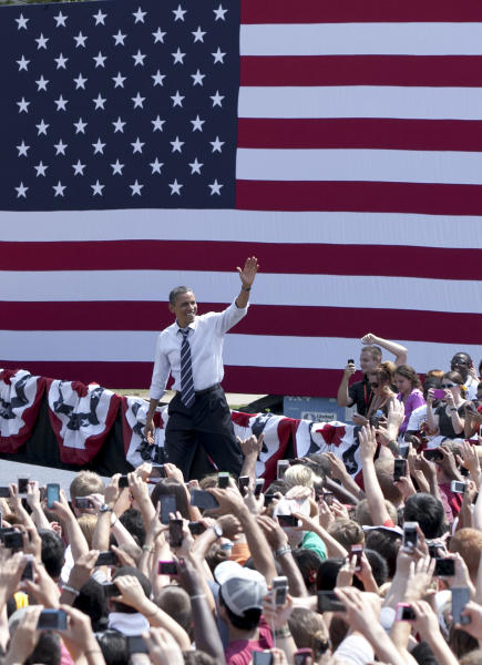 President Barack Obama arrives to a campaign stop in Ames, Iowa, Tuesday, Aug. 28, 2012. The president's event in Ames, home of Iowa State University, is part of a tour through college towns. (AP Photo/Nati Harnik)