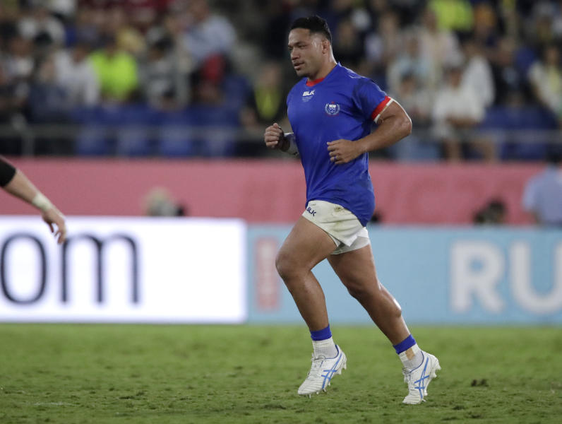 Samoa's Motu Matu'u leaves the field after been shown a yellow card during the Rugby World Cup Pool A game between Russia and Samoa at Kumagaya Rugby Stadium, Kumagaya City, Japan, Tuesday, Sept. 24, 2019. (AP Photo/Jae Hong)