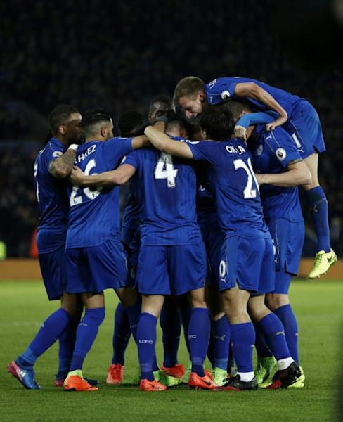 Leicester City's midfielder Danny Drinkwater (C) celebrates with teammates after scoring his team's second goal during the English Premier League football match against Liverpool February 27, 2017