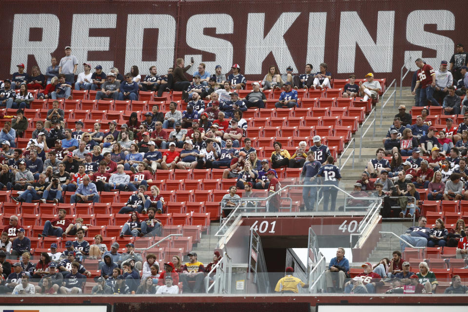 FILE - In this Oct. 6, 2019, file photo, fans watch play between the Washington Redskins and the New England Patriots during the second half of an NFL football game, in Landover, Md. There were more than 20,000 empty seats for the Redskins last home game, and when many of them have been filled this season, its with fans of the visiting team. It could be even emptier Sunday when the 1-9 Redskins host the 3-6-1 Detroit Lions. (AP Photo/Patrick Semansky, File)